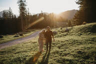 Happy young couple on a hiking trip at sunset, Schwaegalp, Nesslau, Switzerland - LHPF01114