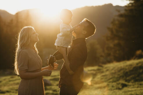 Happy family with little son on a hiking trip at sunset, Schwaegalp, Nesslau, Switzerland - LHPF01120