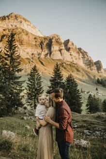 Affectionate family with little son on a hiking trip, Schwaegalp, Nesslau, Switzerland - LHPF01129