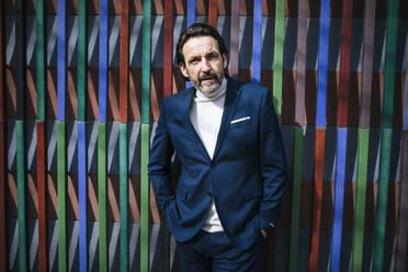 Portrait of mature businessman wearing blue suit - JLOF00329
