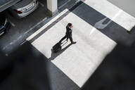 Top view of businessman with baggage on the go - DIGF08509