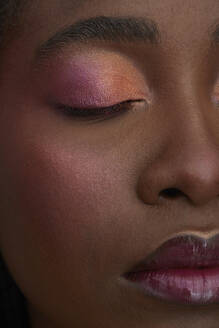 Portrait of African woman, closed eye, close-up, made up - PGCF00035