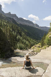 Rear view of woman enjoying the view in the mountains, Ordesa national park, Aragon, Spain - AHSF00850