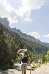 Rear view of woman enjoying the view in the mountains, Ordesa national park, Aragon, Spain - AHSF00853