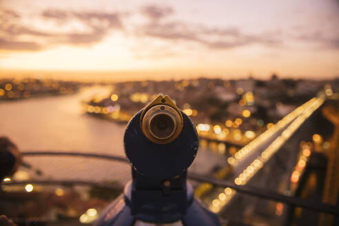 Coin-operated binoculars with view of Porto at sunset, Portugal - AHSF00870