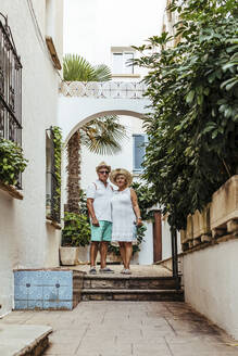 Senior tourist couple in a village, El Roc de Sant Gaieta, Spain - MOSF00035