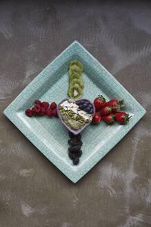 Fruits on plate - JOHF02881