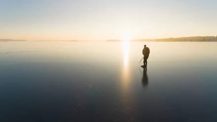 Ice skater on frozen sea - JOHF03034