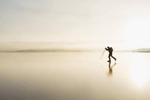 Ice skater on frozen sea - JOHF03037