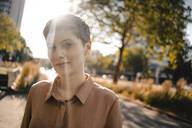 Portrait of confident woman in backlight - KNSF06787