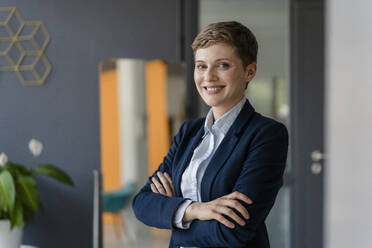 Portrait of confident businesswoman in office - KNSF06802