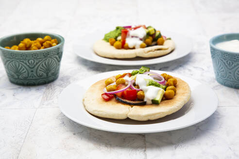 Israelisabichwith pita bread, eggplant, chick-peas, onion, tomato, cucumber, yogurt andzhugsauce - LVF08358