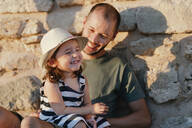 Alcúdia, Mallorca, Spain. Cute two year old little girl and father spending happy quality time together - GEMF03221