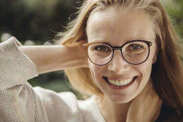 Portrait of happy young woman with glasses - MFF04876