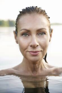 Portrait of mature woman in a lake - PNEF02212
