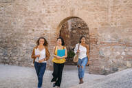 Three happy female friends visiting the city - MPPF00142