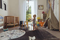 Baby boy playing in his nursery - MFF04928