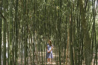Woman standing in a bamboo forest, Aveiro, Portugal - AHSF00944