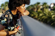 Female Afro-American with smartphone and headphones - ERRF01750
