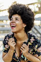 Portrait of laughing Afro-American woman with headphones - ERRF01759
