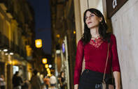 Young woman in the city at night - LJF01069