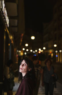 Portrait of a young woman in the city at night - LJF01072
