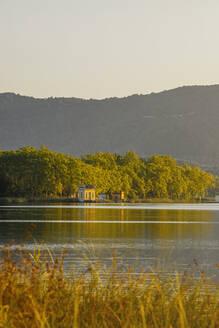 Houses on the shore of Lake Estany de Banyoles, Gerona, Spain - MOSF00105