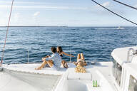 Three young friends enjoying a summer day on a sailboat - MGOF04182