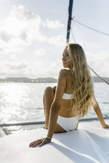 Young beautiful woman on a sailboat - MGOF04185