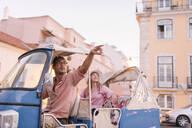 Tuk tuk driver providing tour of the city to a tourist, Lisbon, Portugal - AHSF00990