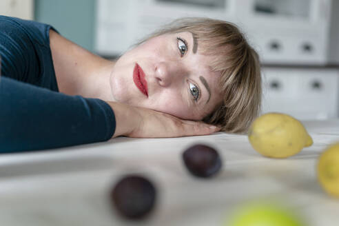 Portrait of woman relaxing at home - KNSF06832