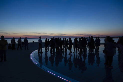 people at the sea organ during night, Zadar, Croatia - NGF00528