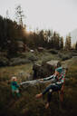 Mother relaxing with toddler daughter in rural valley, Mineral King, California, USA - ISF22357