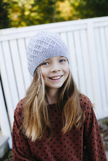 Portrait of a smiling girl outdoors - HMEF00650