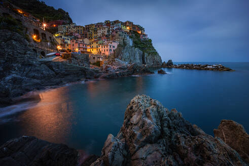 Aerial view of Manarola during the night, Italy - AAEF05085