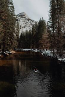 Man kayaking in lake, Yosemite Village, California, United States - ISF22560