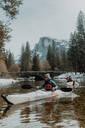 Friends kayaking in lake, Yosemite Village, California, United States - ISF22563
