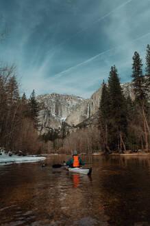 Man kayaking in lake, Yosemite Village, California, United States - ISF22566