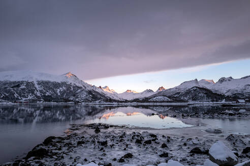 Beautiful calm fjord reflections at sunset in a wintry Lofoten Islands, Nordland, Arctic, Norway, Europe - RHPLF12602