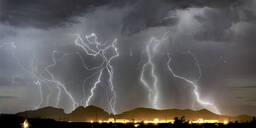 Lightning striking Saddleback Mountain just west of Tonopah, Arizona, United States of America, North America - RHPLF12617
