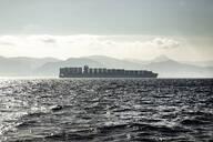 Spain, Andalucia, Tarifa, Freight ship in Strait of Gibraltar - KBF00619
