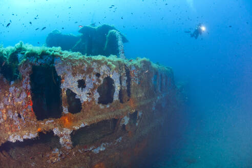 France, Corsica, Sunken shipwreck of Alcione C tanker with scuba diver in background - ZC00828