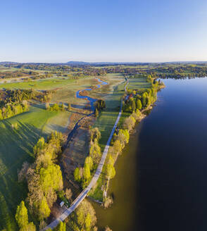 Germany, Bavaria, Uffing am Staffelsee, Aerial view of country road stretching between river Ach and shore of Staffelsee lake - SIEF09201