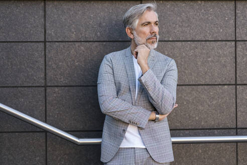 Fashionable mature businessman standing outdoors - DIGF08573