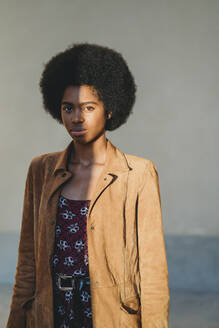 Young woman with afro hair in corridor - CUF52569