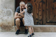 Little girl kissing her father outdoors, Mallorca, Spain - GEMF03243
