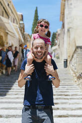 Portrait of happy father with little daughter on his shoulders, Pollenca, Mallorca, Spain - GEMF03252