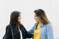 Two women talking during shopping - JRFF03797