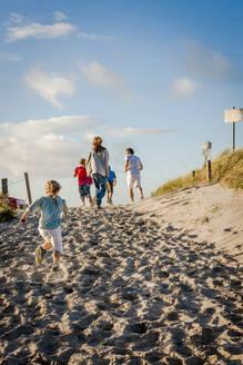 Family running from a beach, Darss, Mecklenburg-Western Pomerania, Germany - EGBF00437