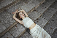 Young woman lying on the steps - CAVF66044